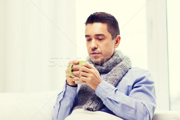 Ziek man griep drinken hot thee Stockfoto © dolgachov