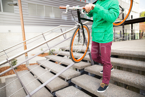 man with fixed gear bike going downstairs Stock photo © dolgachov