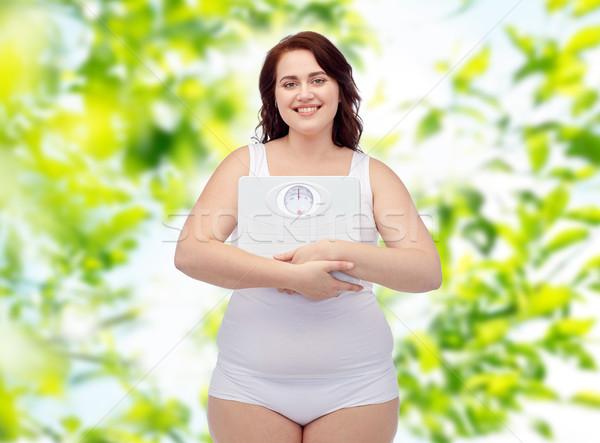 Felice giovani plus size donna scale Foto d'archivio © dolgachov