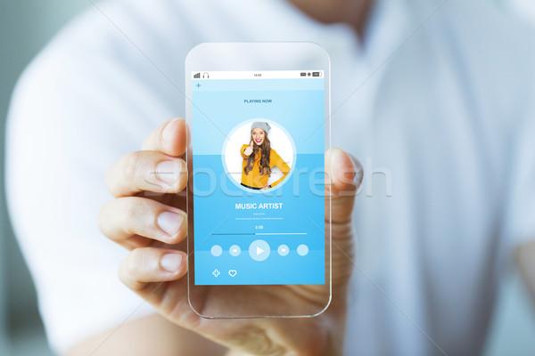 Hand muziekspeler smartphone technologie media Stockfoto © dolgachov