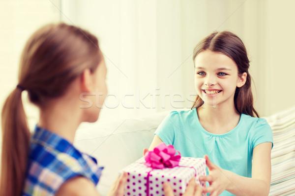 happy little girls with birthday present at home Stock photo © dolgachov