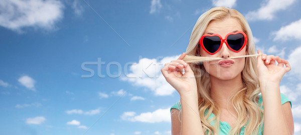 happy young woman making mustache with her hair Stock photo © dolgachov