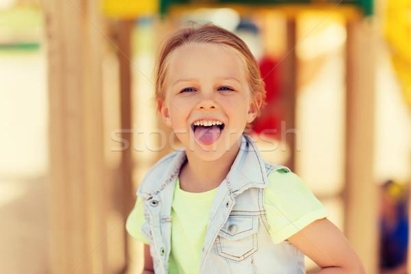 Feliz nina lengua Zona de juegos verano Foto stock © dolgachov
