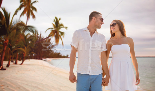 Gelukkig glimlachend paar zomer strand zee Stockfoto © dolgachov