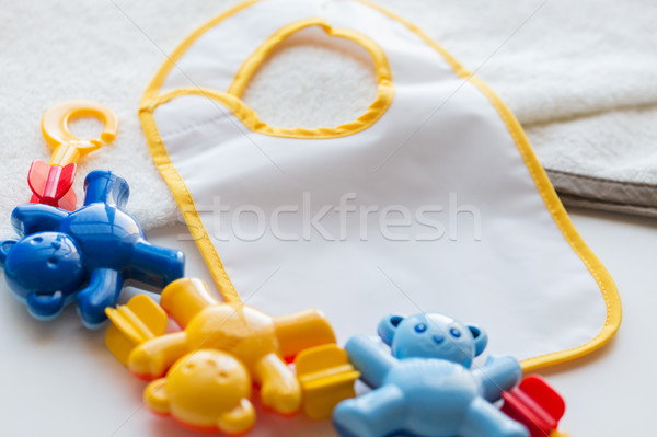 close up of baby rattle and bib for newborn Stock photo © dolgachov
