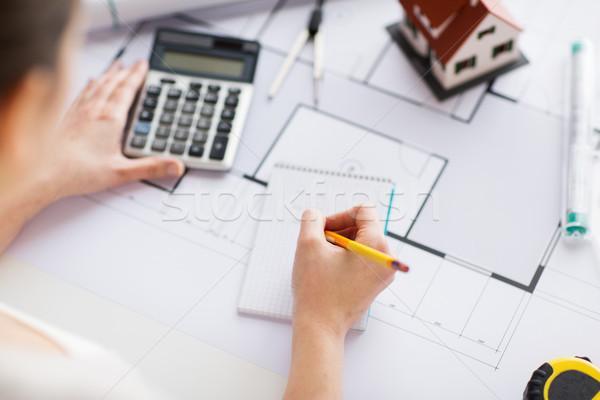 close up of hand on blueprint writing to notebook Stock photo © dolgachov