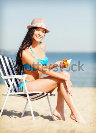 Mulher banhos de sol protetor solar praia férias de verão turismo Foto stock © dolgachov