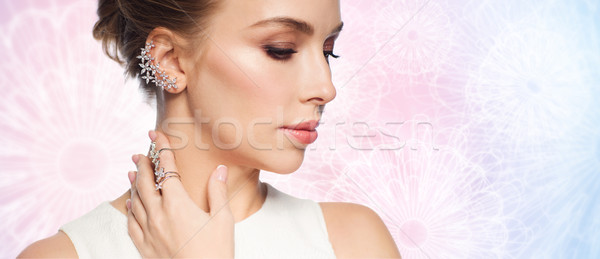 Stock photo: smiling woman in white dress with diamond jewelry