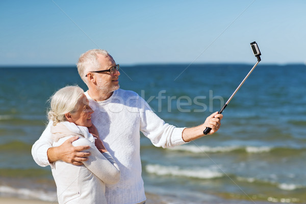 happy senior couple hugging on summer beach Stock photo © dolgachov