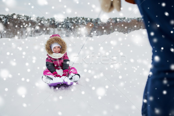 parent carrying happy little kid on sled in winter Stock photo © dolgachov
