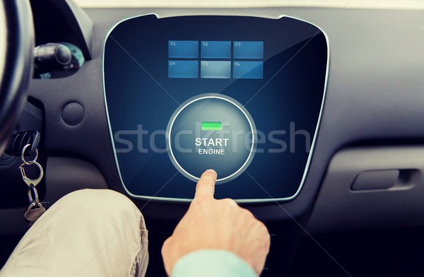 close up of man using starter application in car Stock photo © dolgachov