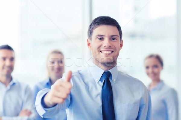Sorridere imprenditore ufficio uomini d'affari Foto d'archivio © dolgachov