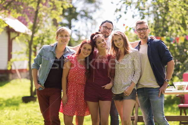 happy teenage friends hugging at summer garden Stock photo © dolgachov