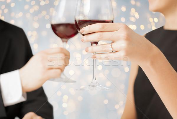 close up of engaged couple with wine glasses Stock photo © dolgachov