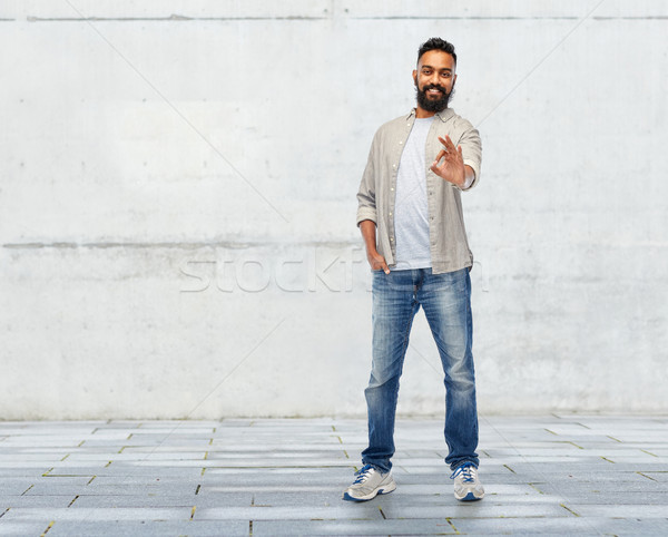 happy smiling indian man showing ok hand sign Stock photo © dolgachov