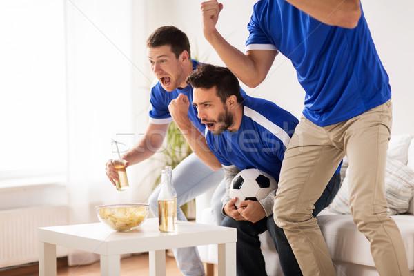 Сток-фото: друзей · футбола · вентиляторы · смотрят · Футбол · домой