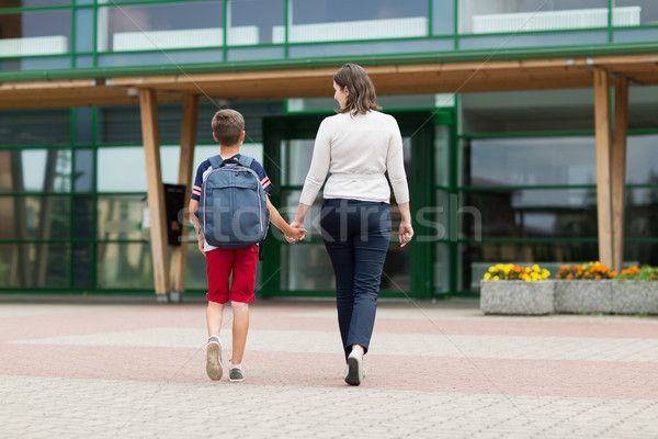 elementary student boy with mother going to school Stock photo © dolgachov
