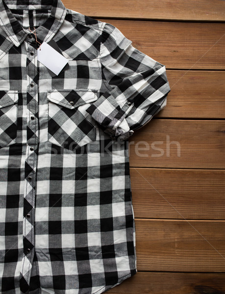 close up of checkered shirt on wooden background Stock photo © dolgachov