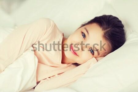 Mutlu gülen kız uyanık yatak ev Stok fotoğraf © dolgachov