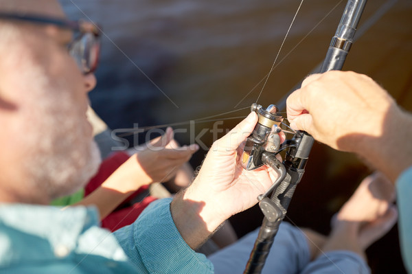 Supérieurs homme canne à pêche rivière famille génération Photo stock © dolgachov