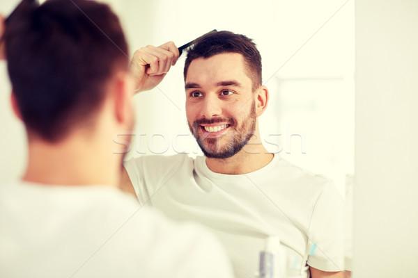 Glücklich Mann Haar Kamm Bad Schönheit Stock foto © dolgachov
