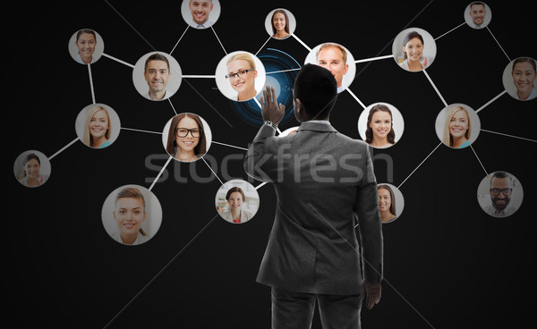 businessman working with network contacts icons Stock photo © dolgachov