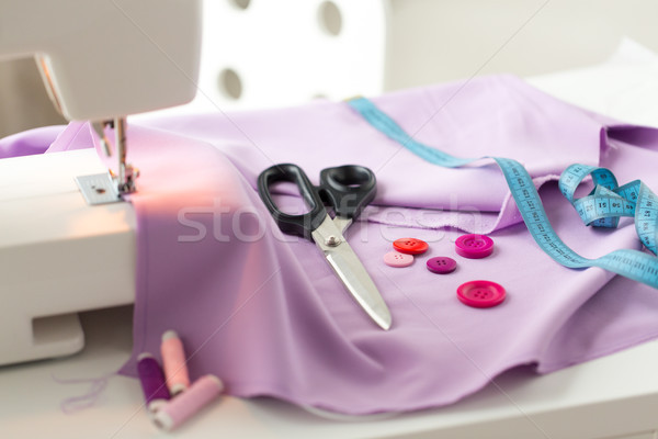 sewing machine, scissors, buttons and fabric Stock photo © dolgachov