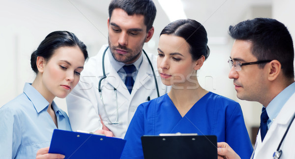 group of medics with clipboards at hospital Stock photo © dolgachov