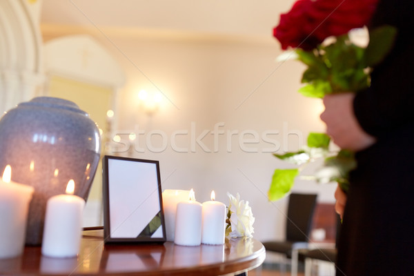 cremation urn and woman at funeral in church Stock photo © dolgachov