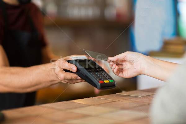 hands with payment terminal and credit card Stock photo © dolgachov