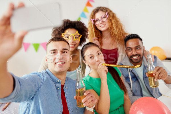 happy team taking selfie at office party Stock photo © dolgachov