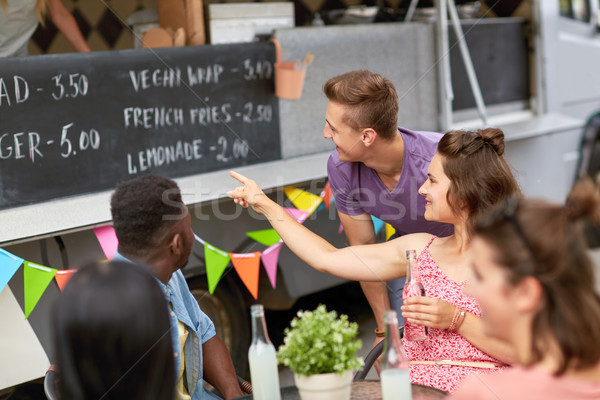 happy customers or friends at food truck Stock photo © dolgachov
