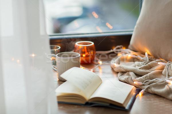 Könyv kávé forró csokoládé ablak kényelmes otthon Stock fotó © dolgachov