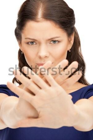 woman making stop gesture Stock photo © dolgachov