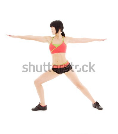 woman practicing virabhadrasana warrior pose Stock photo © dolgachov