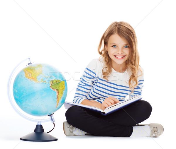 Ragazza mondo libro istruzione scuola piccolo Foto d'archivio © dolgachov