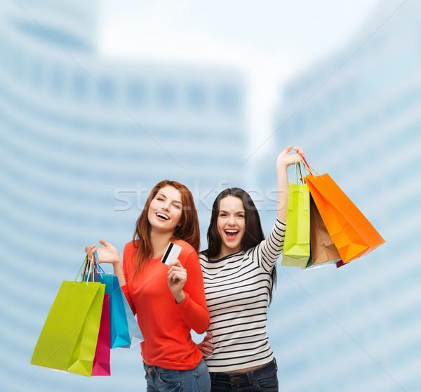 Adolescentes carte de crédit Shopping vente cadeaux Photo stock © dolgachov