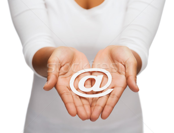 womans cupped hands showing e-mail cutout sign Stock photo © dolgachov