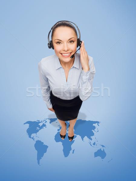 Barátságos női segélyvonal kezelő fejhallgató üzlet Stock fotó © dolgachov
