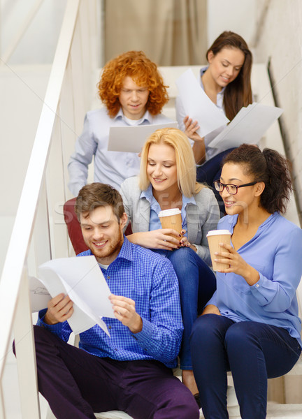team with papers and take away coffee on staircase Stock photo © dolgachov