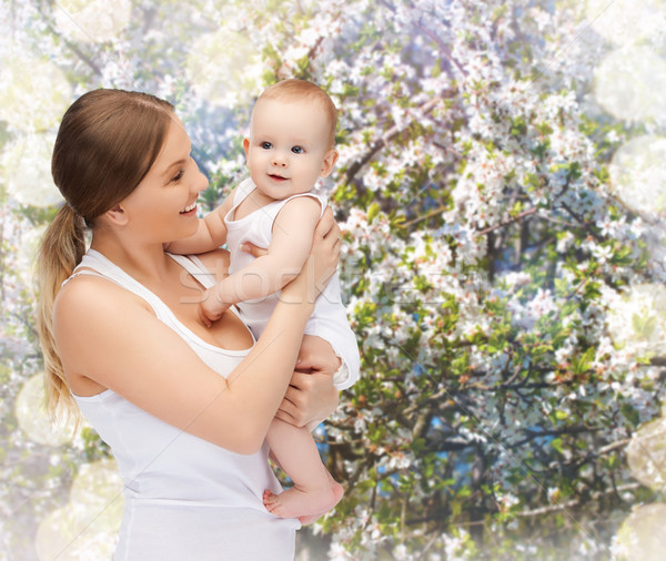 happy mother with adorable baby Stock photo © dolgachov