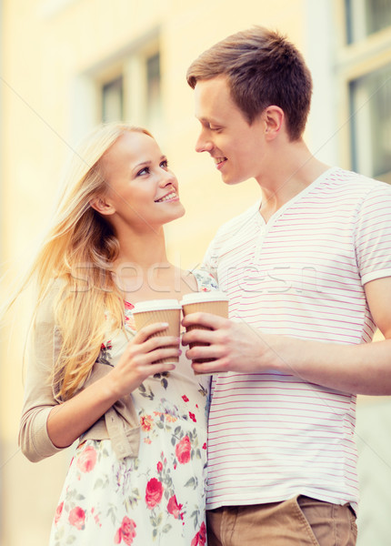 couple in the city with takeaway coffee cups Stock photo © dolgachov