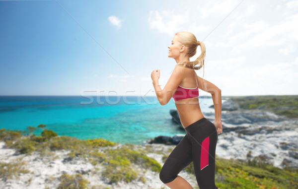 sporty woman running or jumping Stock photo © dolgachov
