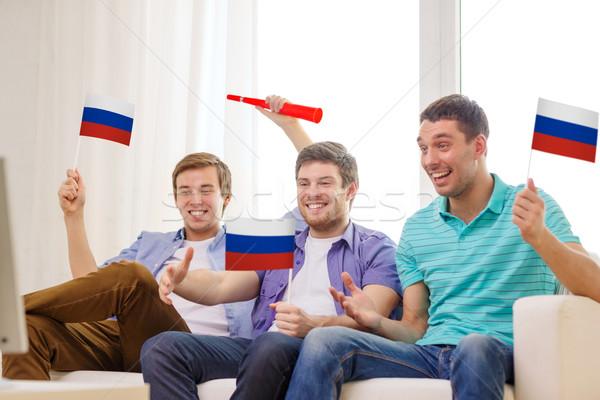 Szczęśliwy mężczyzna znajomych flagi przyjaźni sportowe Zdjęcia stock © dolgachov