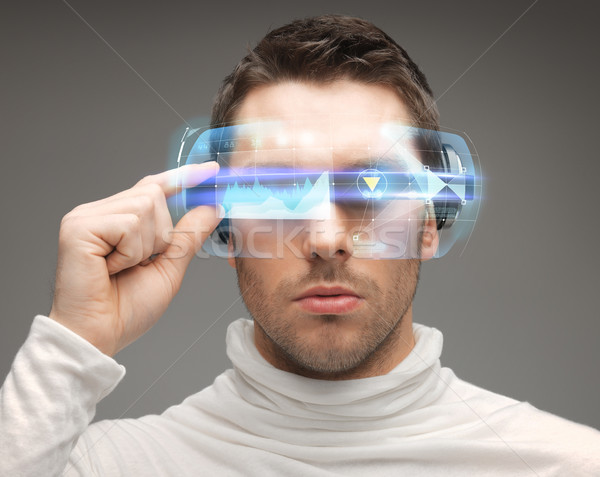 Adam fütüristik gözlük gelecek teknoloji insanlar Stok fotoğraf © dolgachov