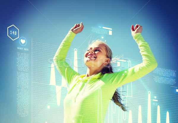 woman runner celebrating victory Stock photo © dolgachov