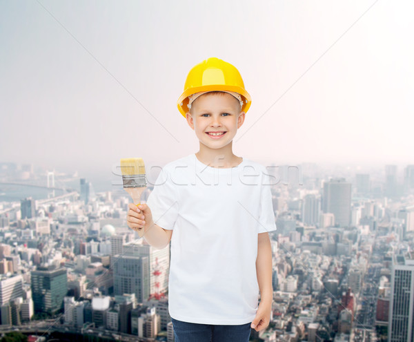 Sorridente little girl capacete paint brush pintura edifício Foto stock © dolgachov