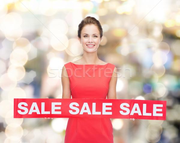 Mosolyog fiatal nő ruha piros vásár felirat Stock fotó © dolgachov