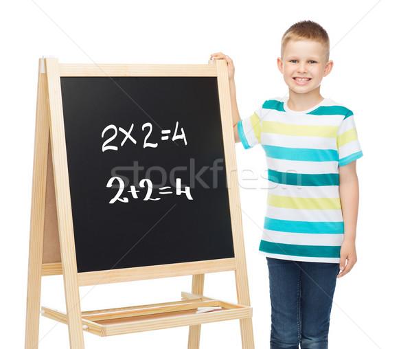Glimlachend weinig jongen Blackboard mensen jeugd Stockfoto © dolgachov