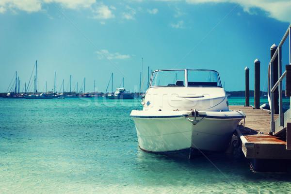 white boat at blue sea Stock photo © dolgachov